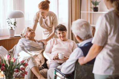 caregiver comforting seniors